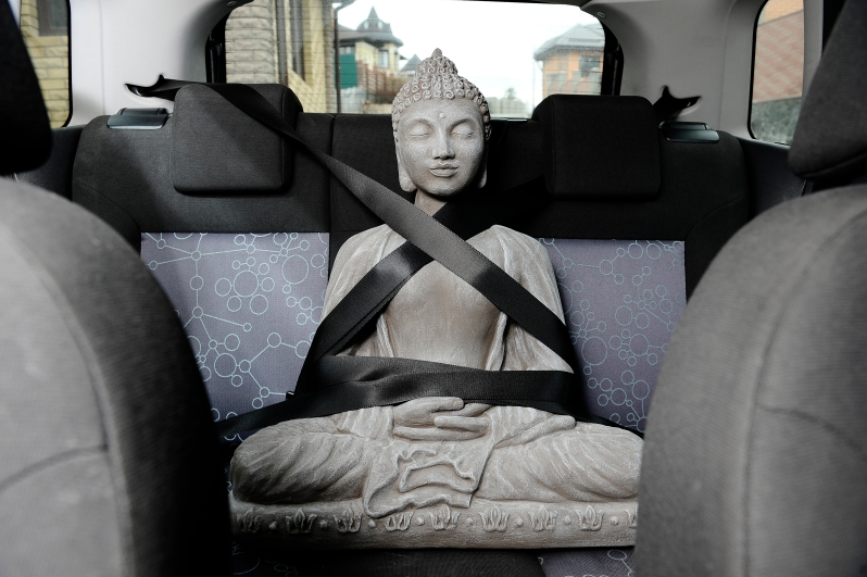 The peaceful Buddha in the car